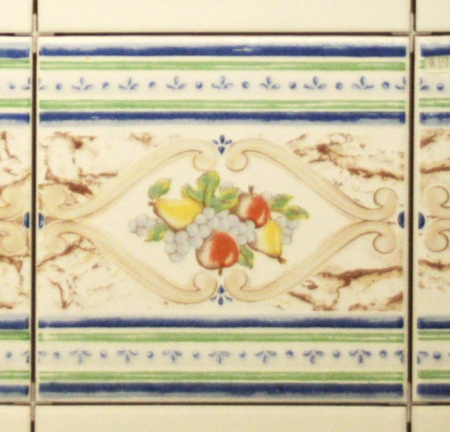 Sintra Ceramic tile Border Features blue green and brown borders surrounding two apples two pears and a bunch of grapes